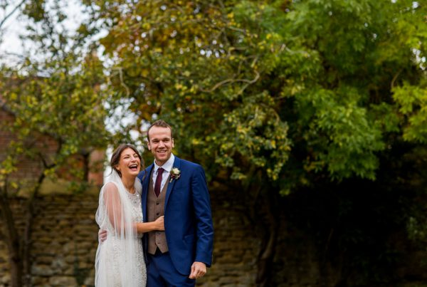Cotswold wedding photographer Elliot W Patching taking shot of bride and groom laughing