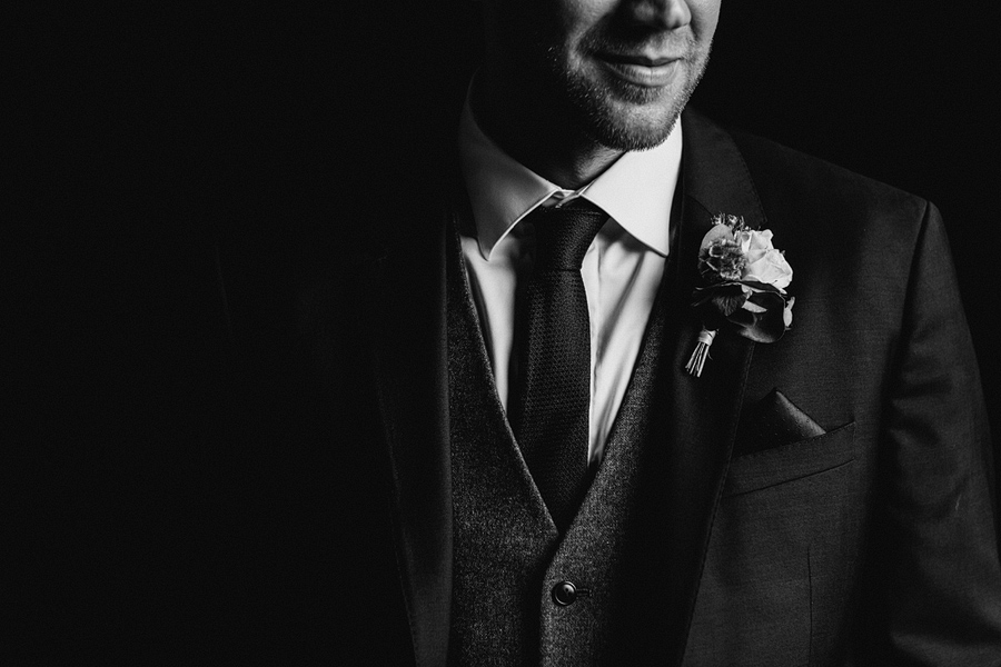 reportage style portrait of the groom - photography by Dodford Manor wedding photogrpaher - Elliot W Patching