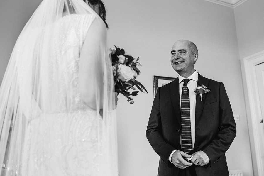 reportage photography of father and bride, shot by Dodford Manor wedding photographer
