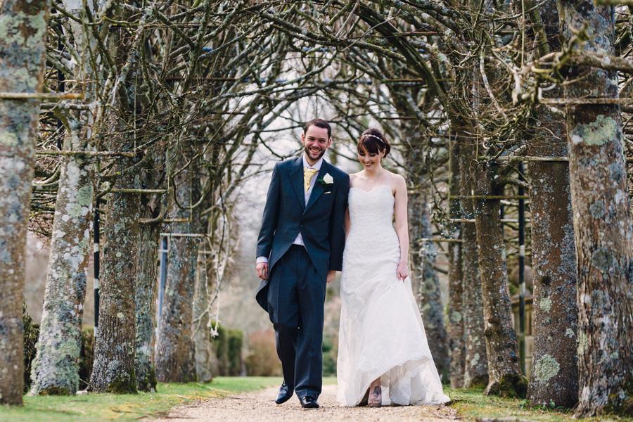 a loving couple takes a walk through some trees