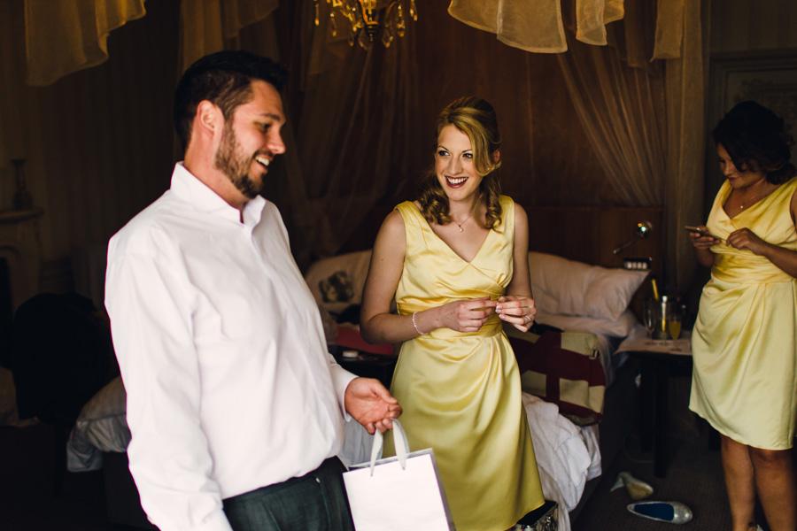 A bridesmaid wearing a yellow bridesmaids dress