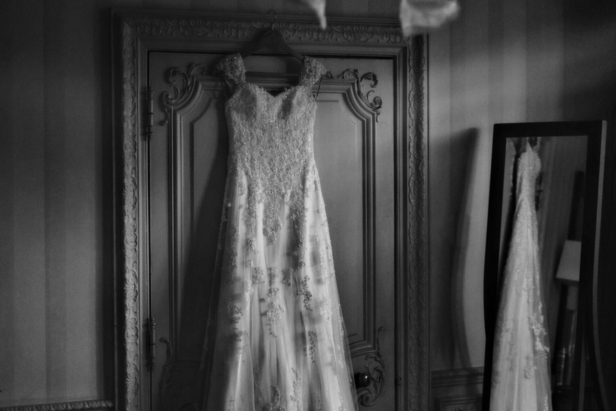 a black and white image of a wedding dress