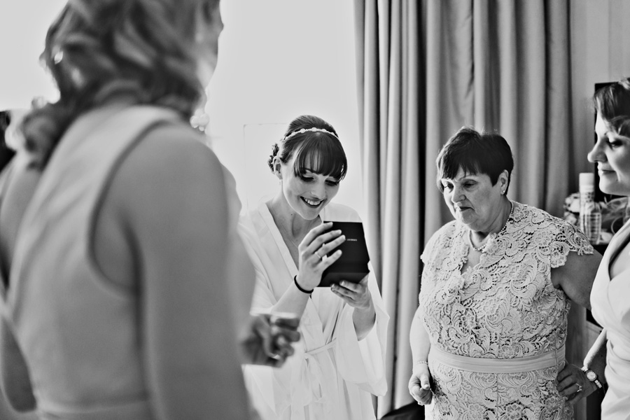 a bride receives a wedding present from the groom