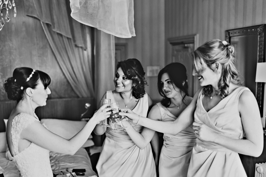 a bride and her bridesmaids drink champagne