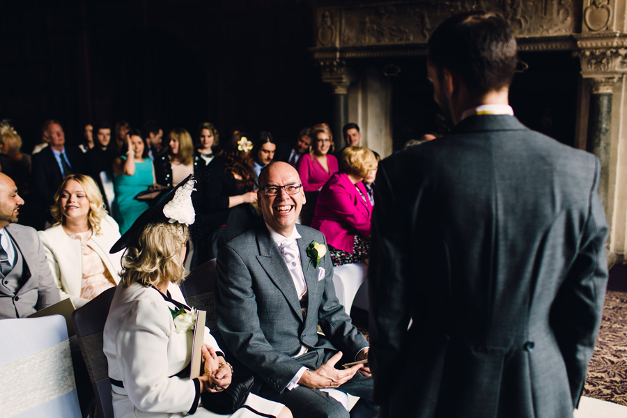 the father of the groom laughs
