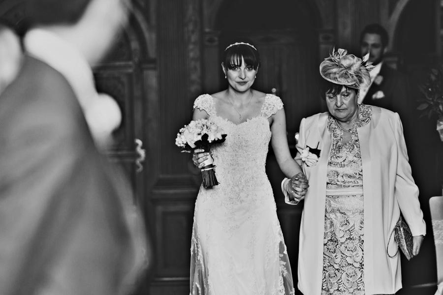 a bride walks down the aisle