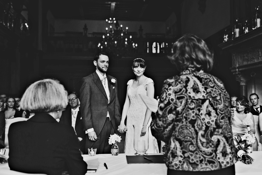 a black and white photograph of a wedding ceremony