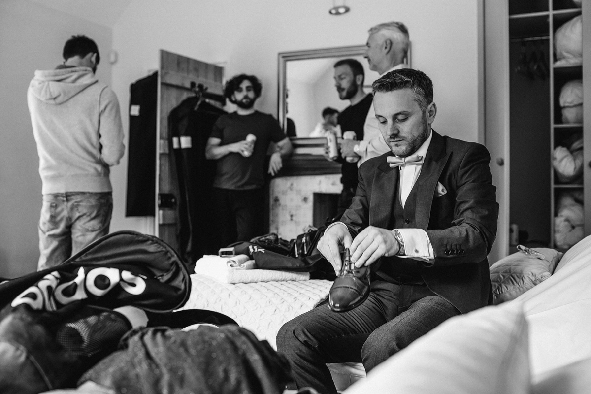 the groom prepares for his wedding