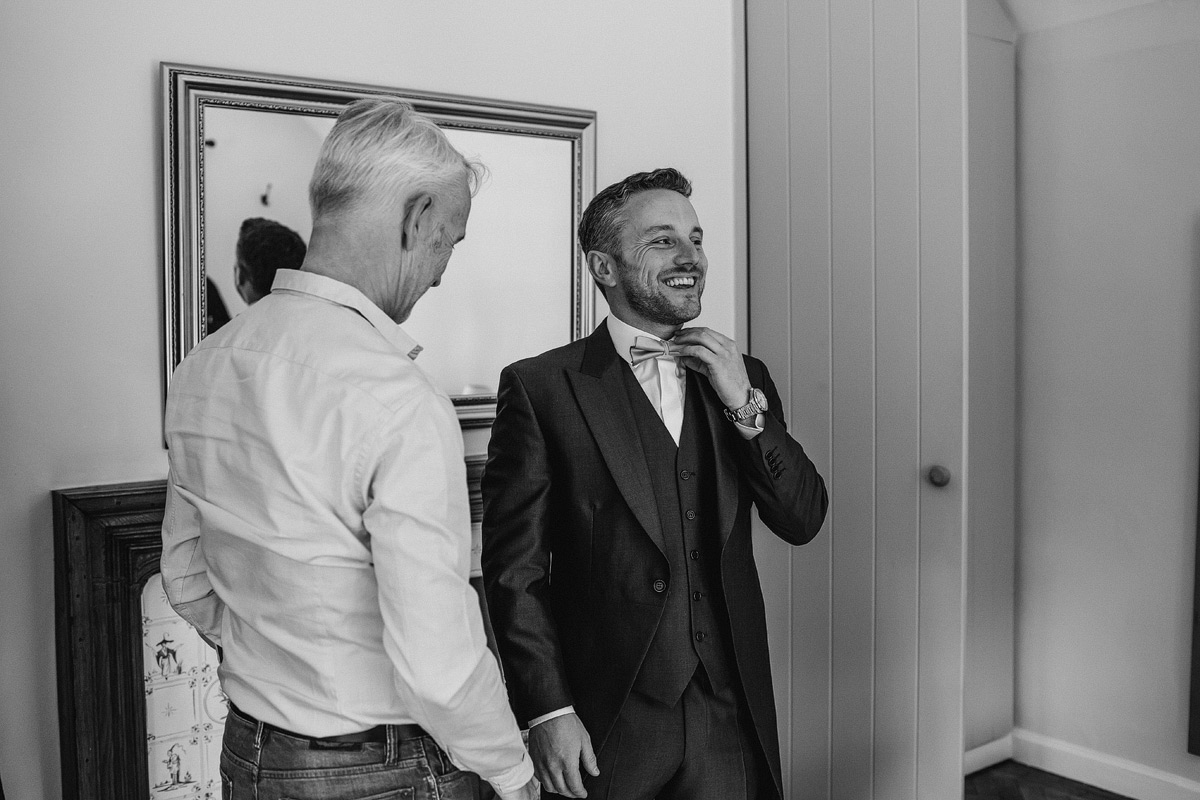 a smiling and happy groom