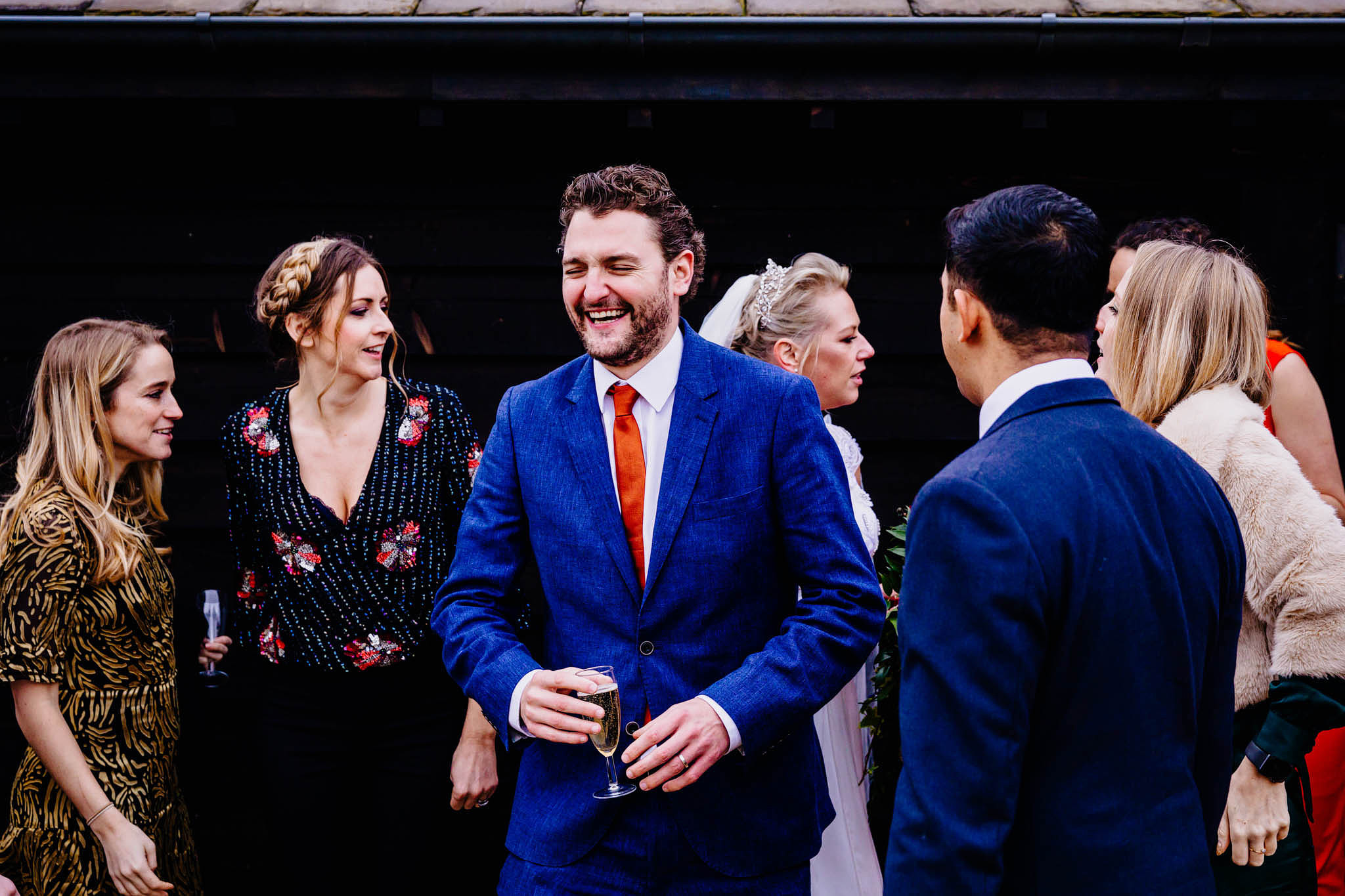 happy, smiling wedding guests