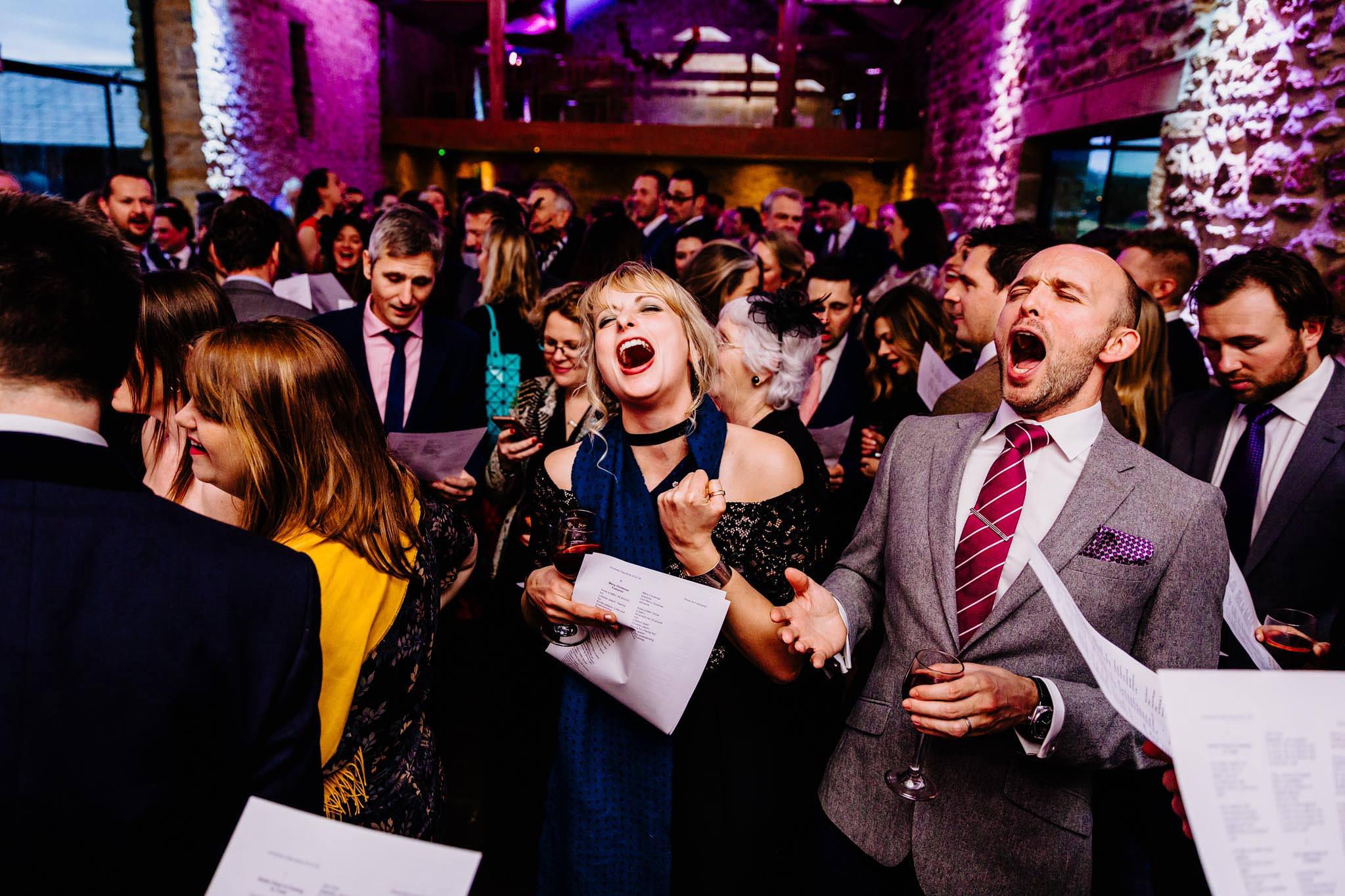 wedding guests singing carols