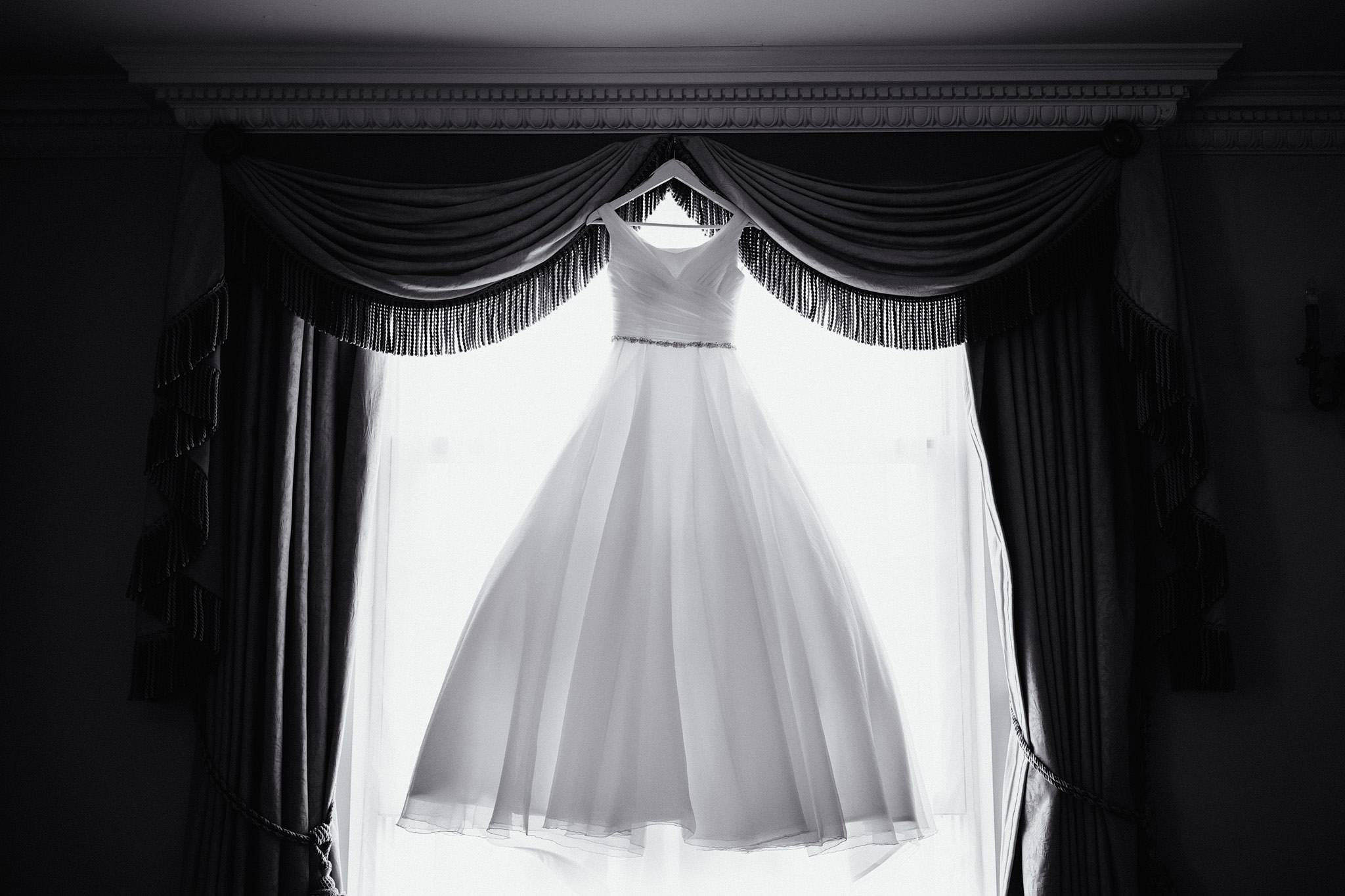 a black and white images of a wedding dress