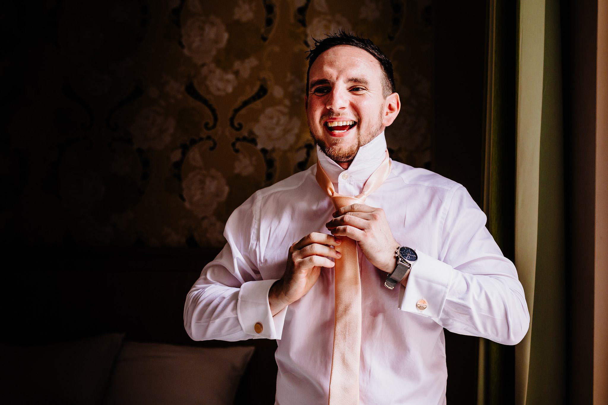 a groom laughing