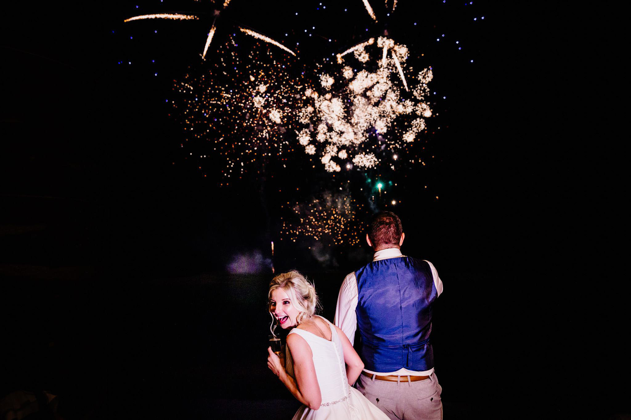 a happy bride enjoying fireworks
