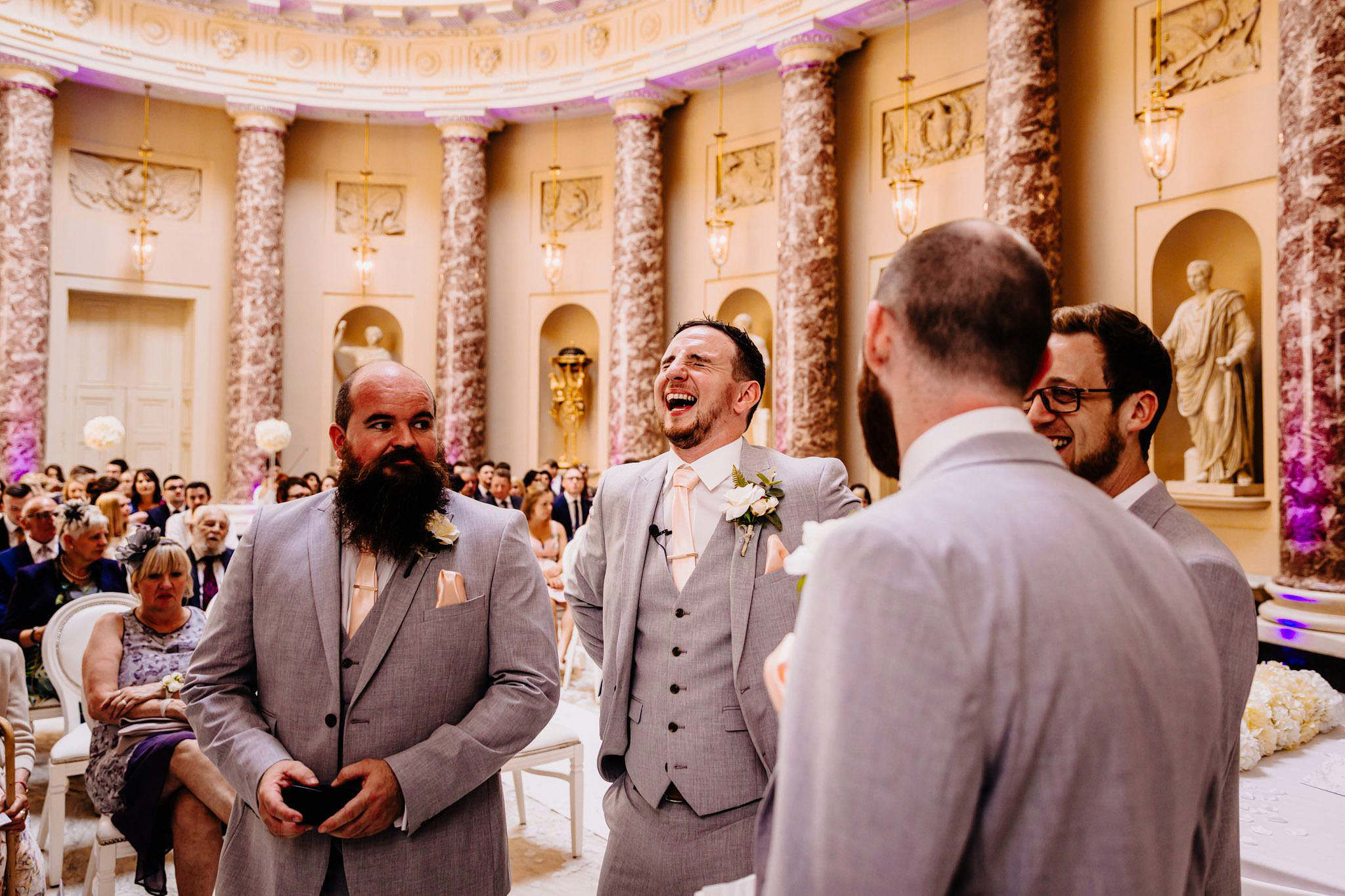a groom laughing before getting married