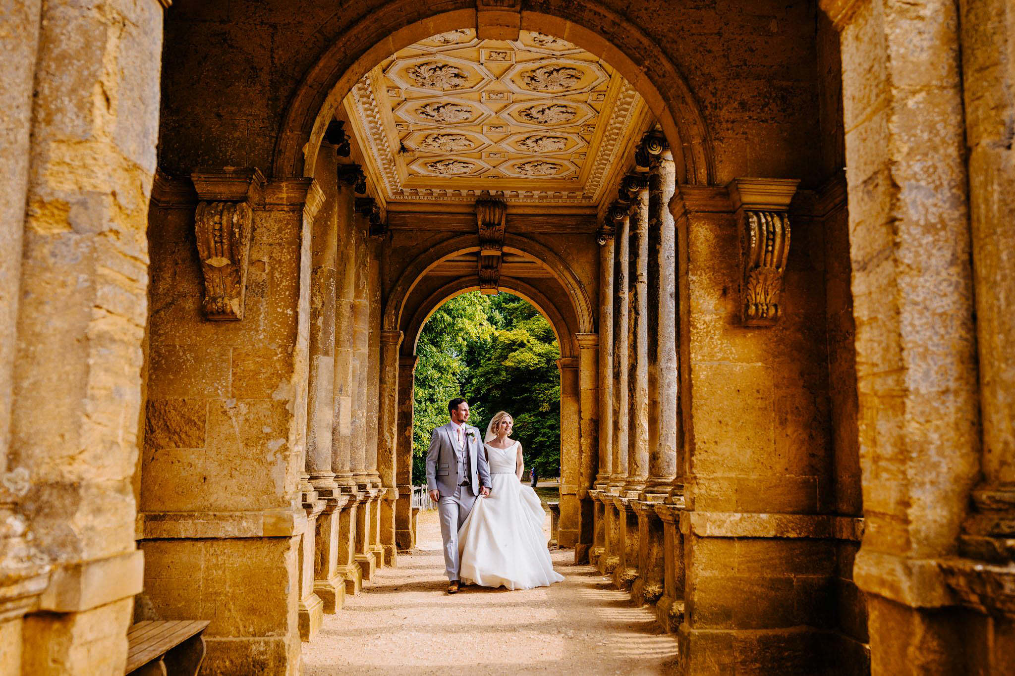 a bride and groom taking a scenic walk