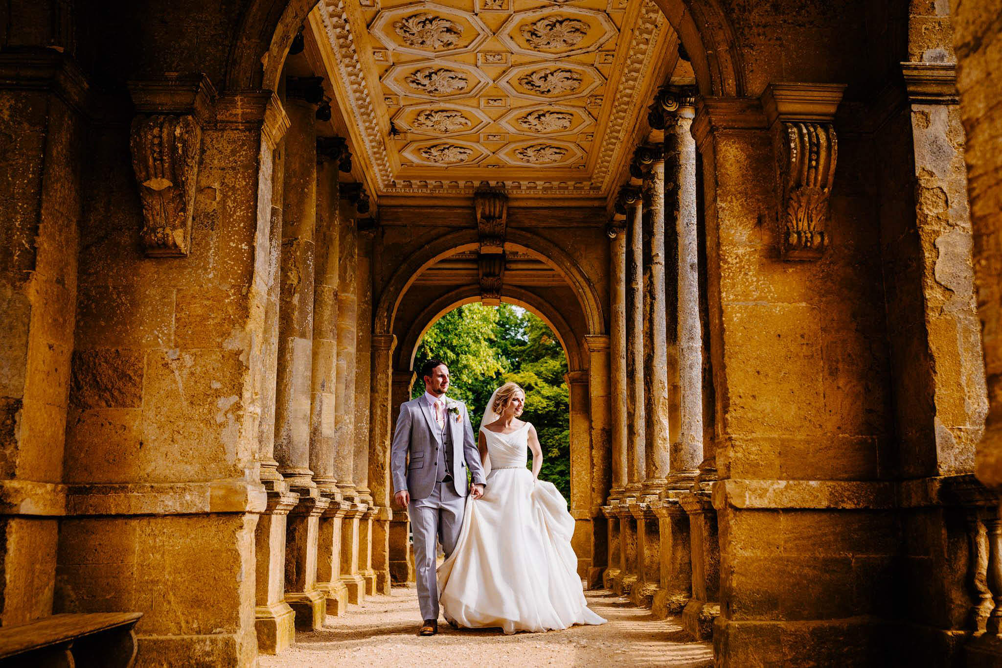 a bride and groom in beautiful surroundings