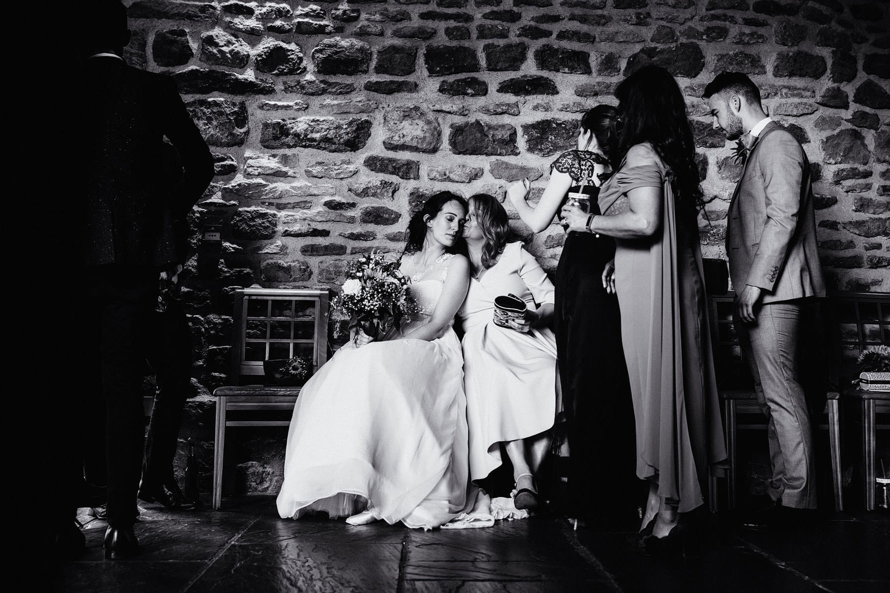 a beautiful moment between the bride and her mother