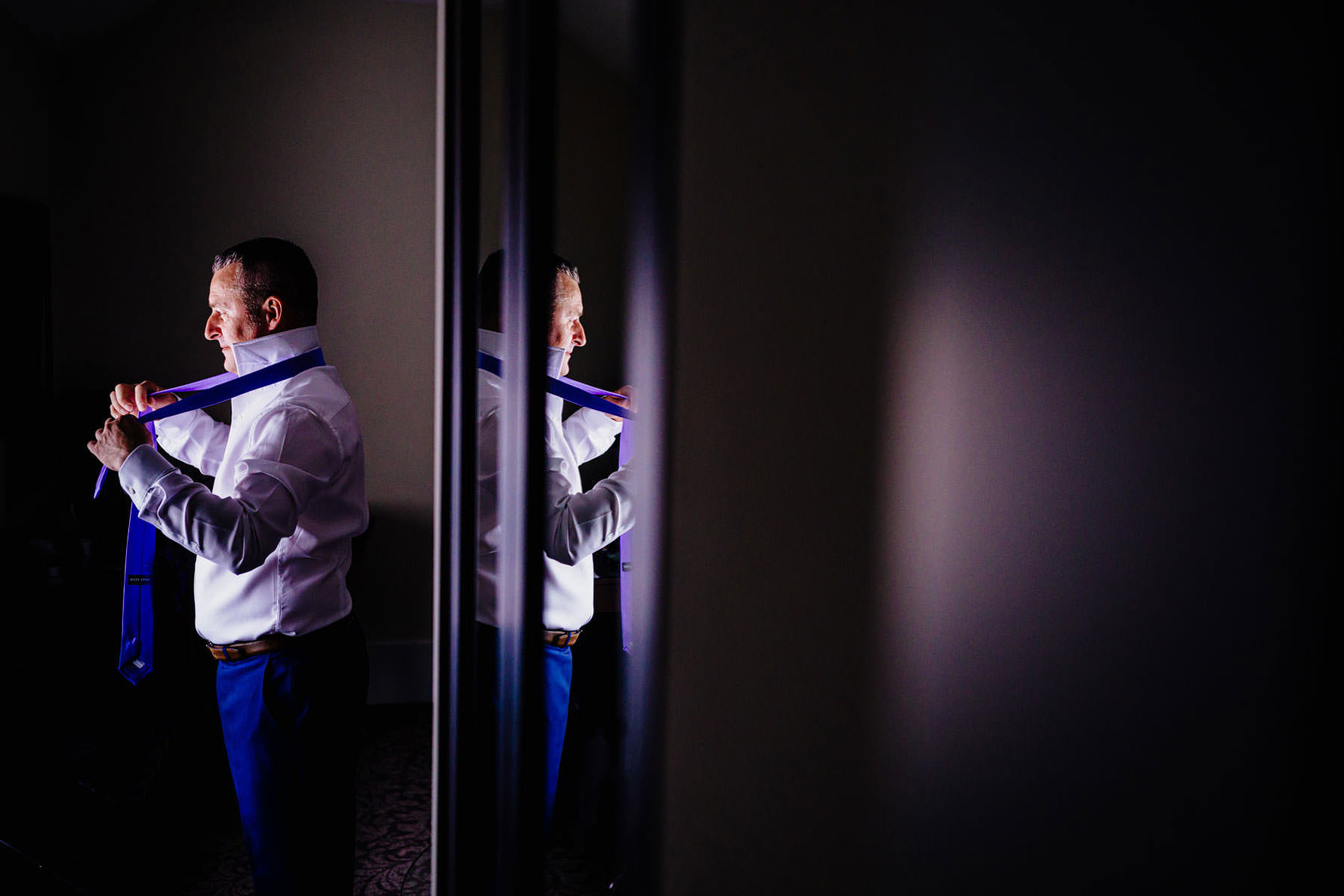 a reflection of a groom
