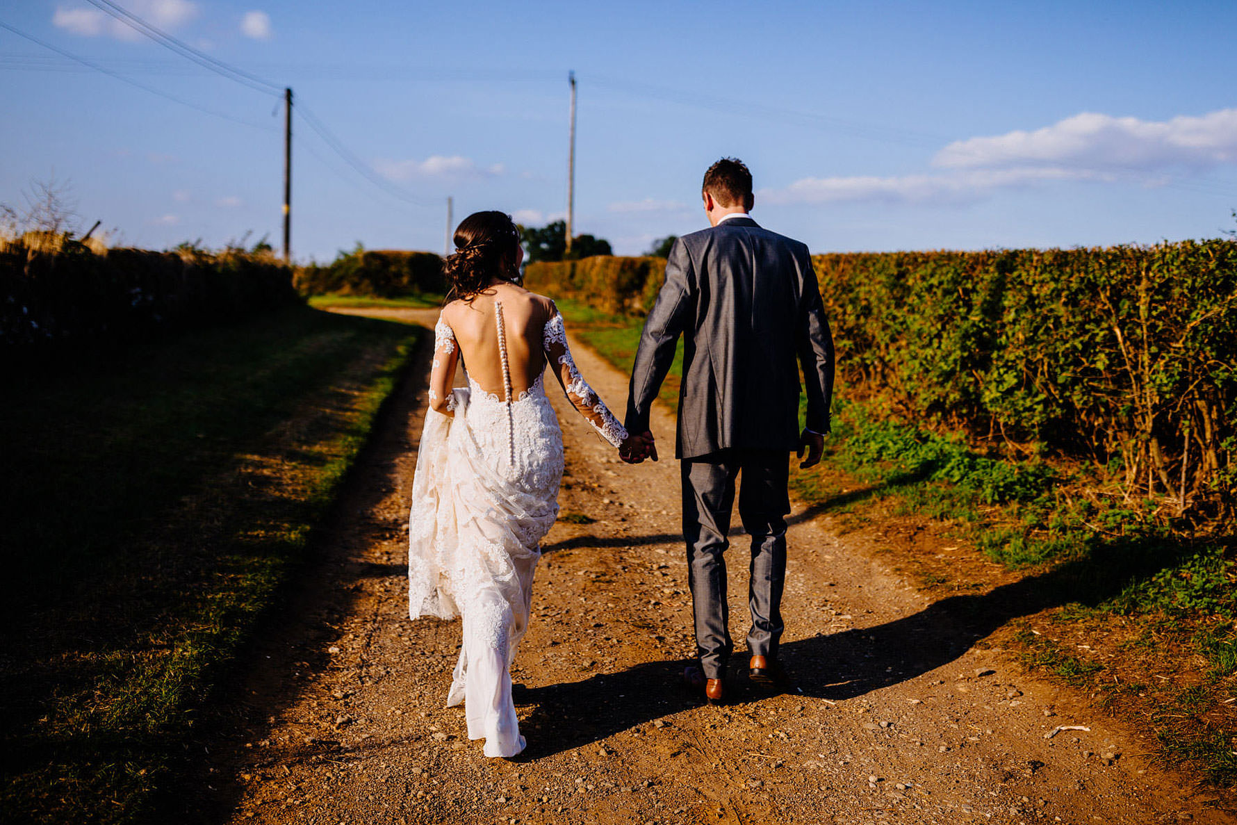 a bride and groom take a walk