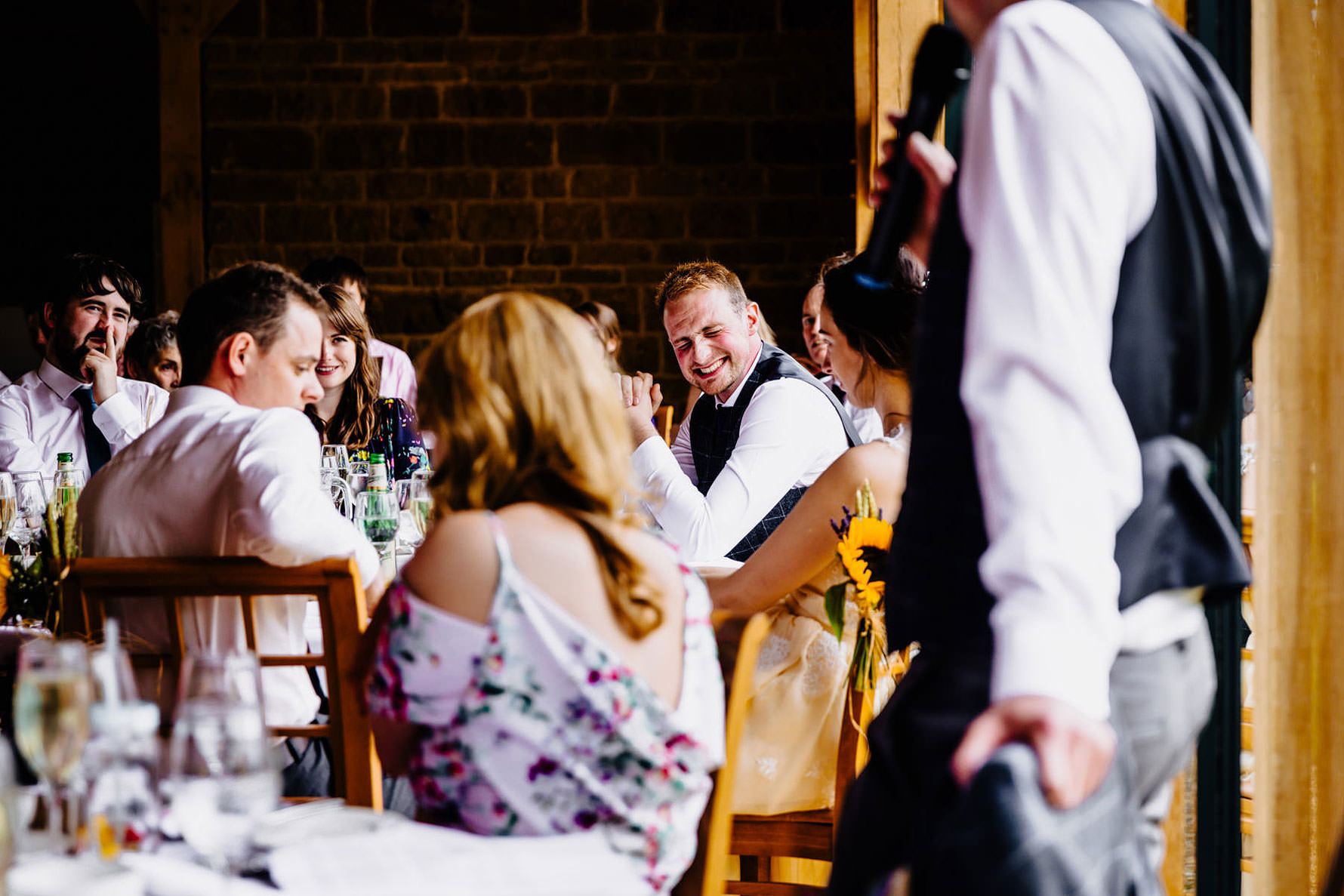 a bestman telling a joke during a speech