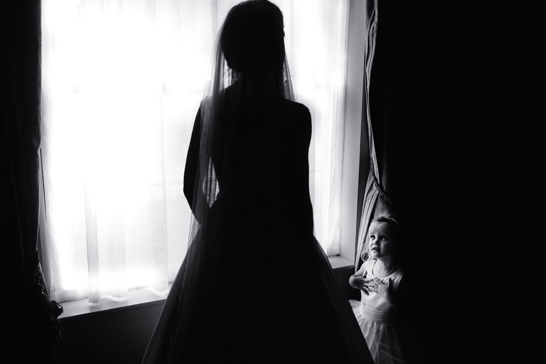 a little girl gazing at a bride