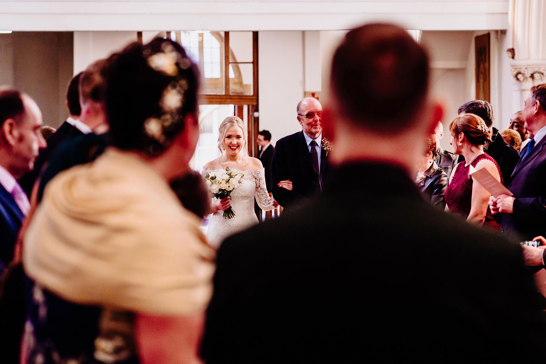 a bride and her father walking down the aisle