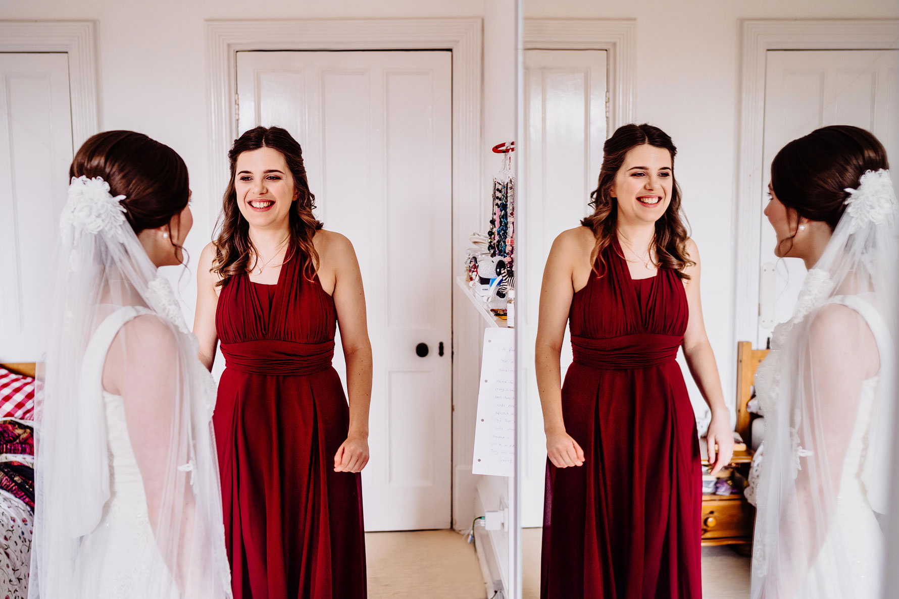 a bridesmaid looks excitedly at a bride