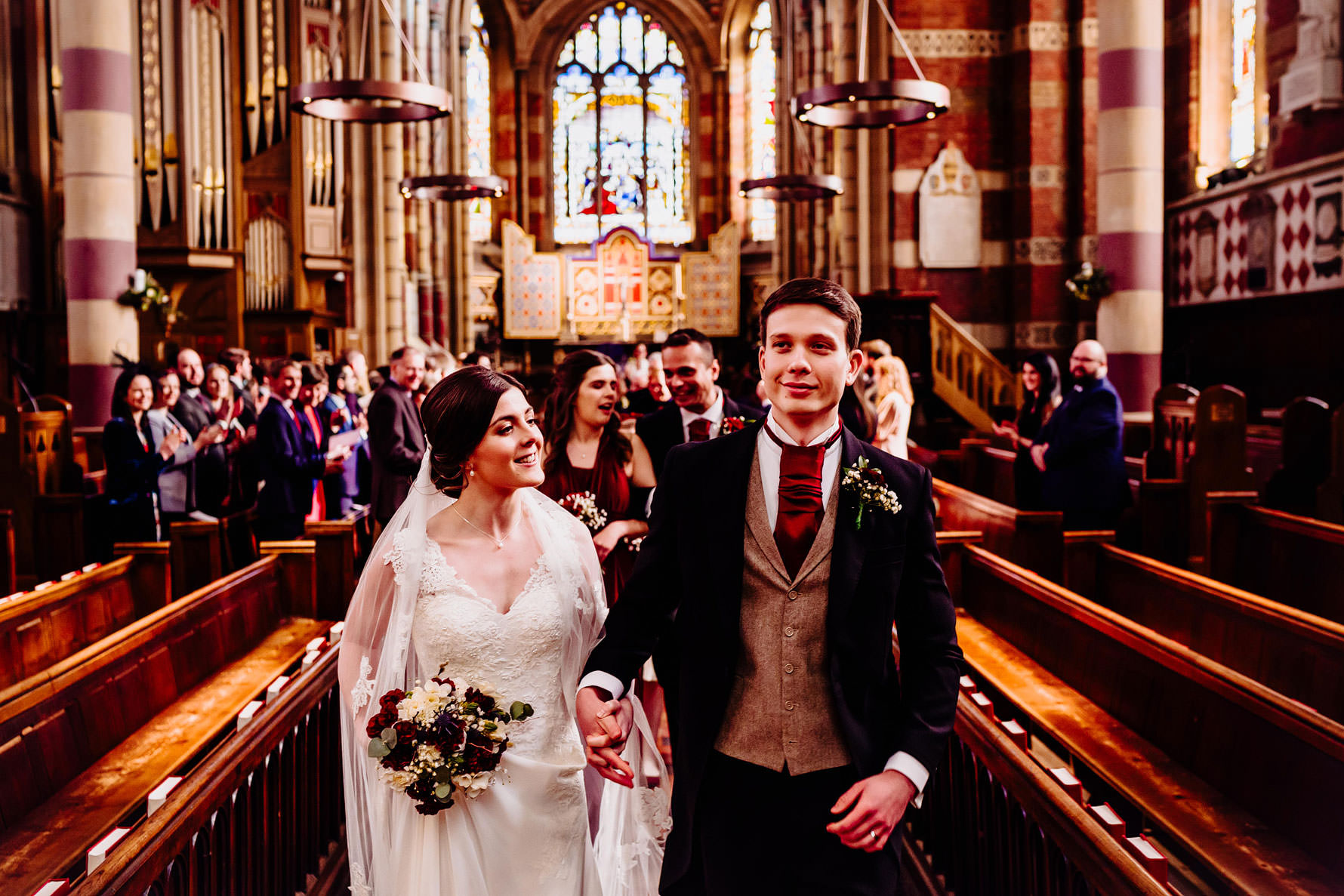 a newly married couple walk up the aisle