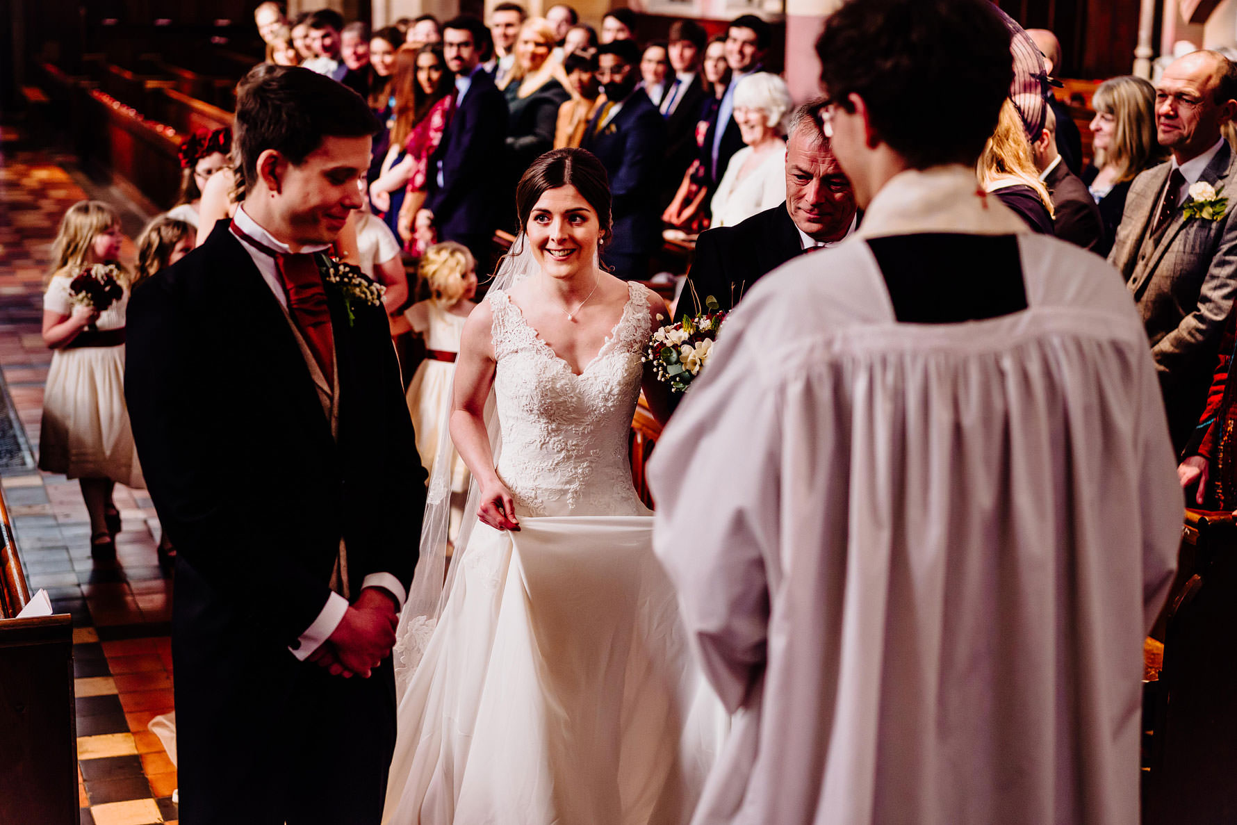 an excited bride sees her groom for the first time
