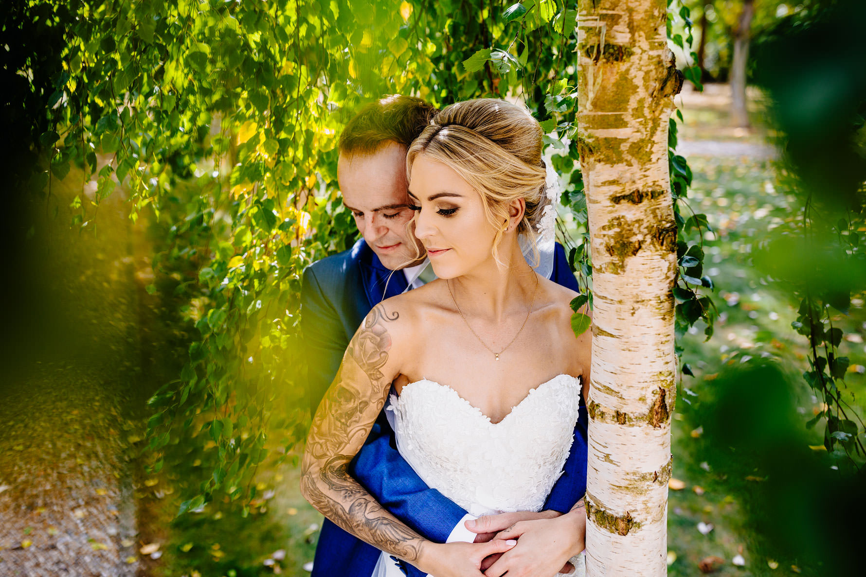 a bride and groom embrace