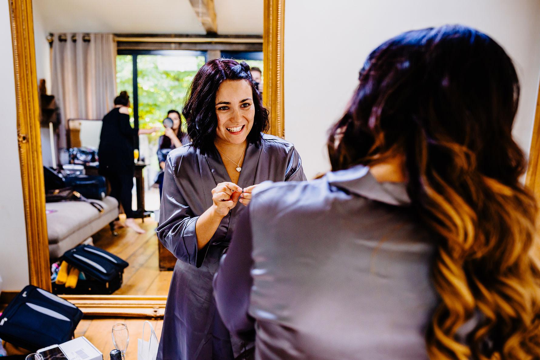 a bridesmaid during bridal preparations