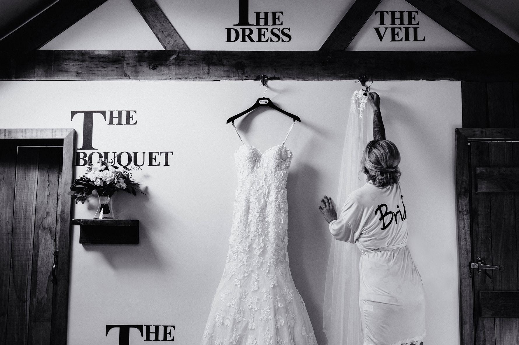 a bride hangs up her dress