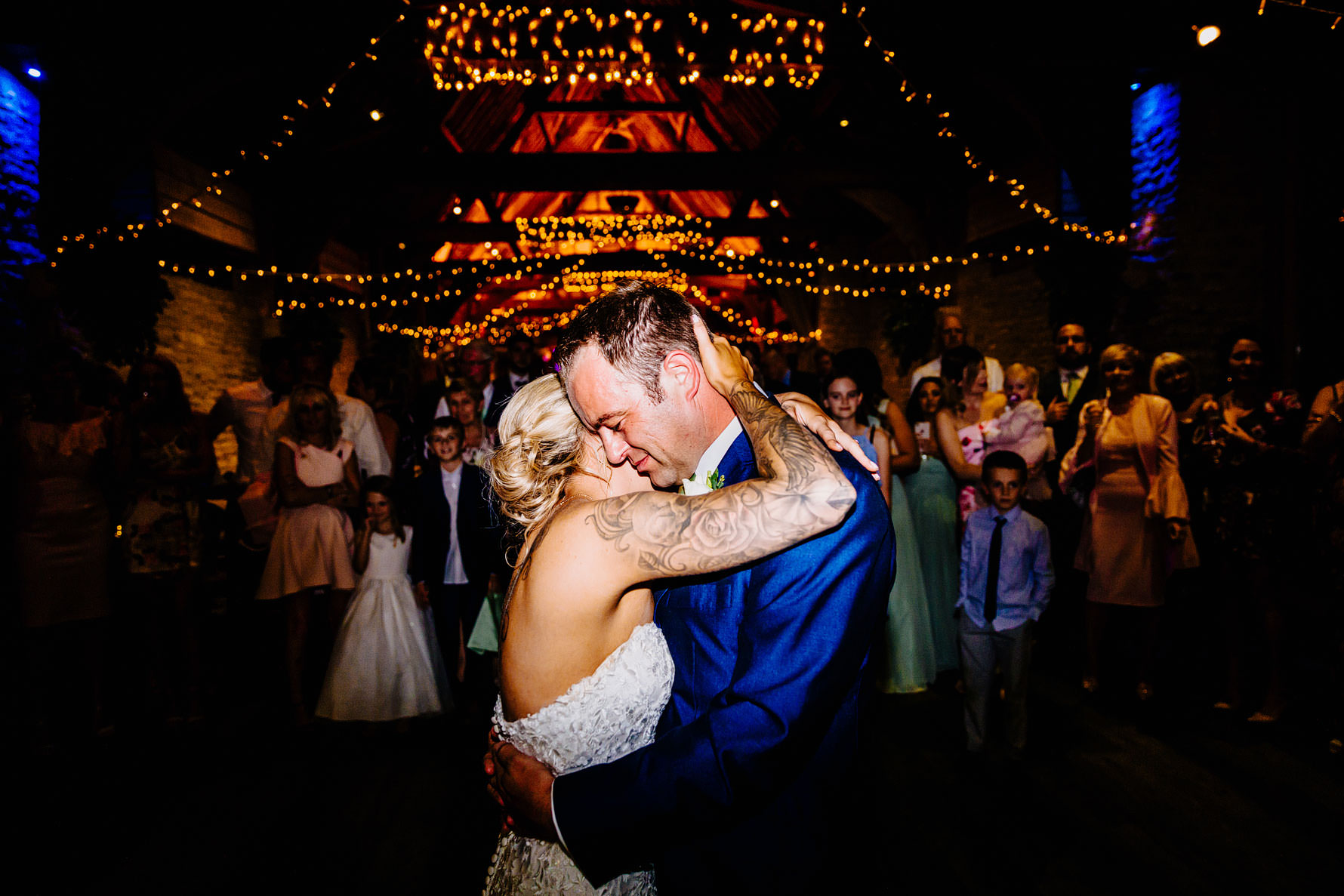 a tender moment between a bride and groom