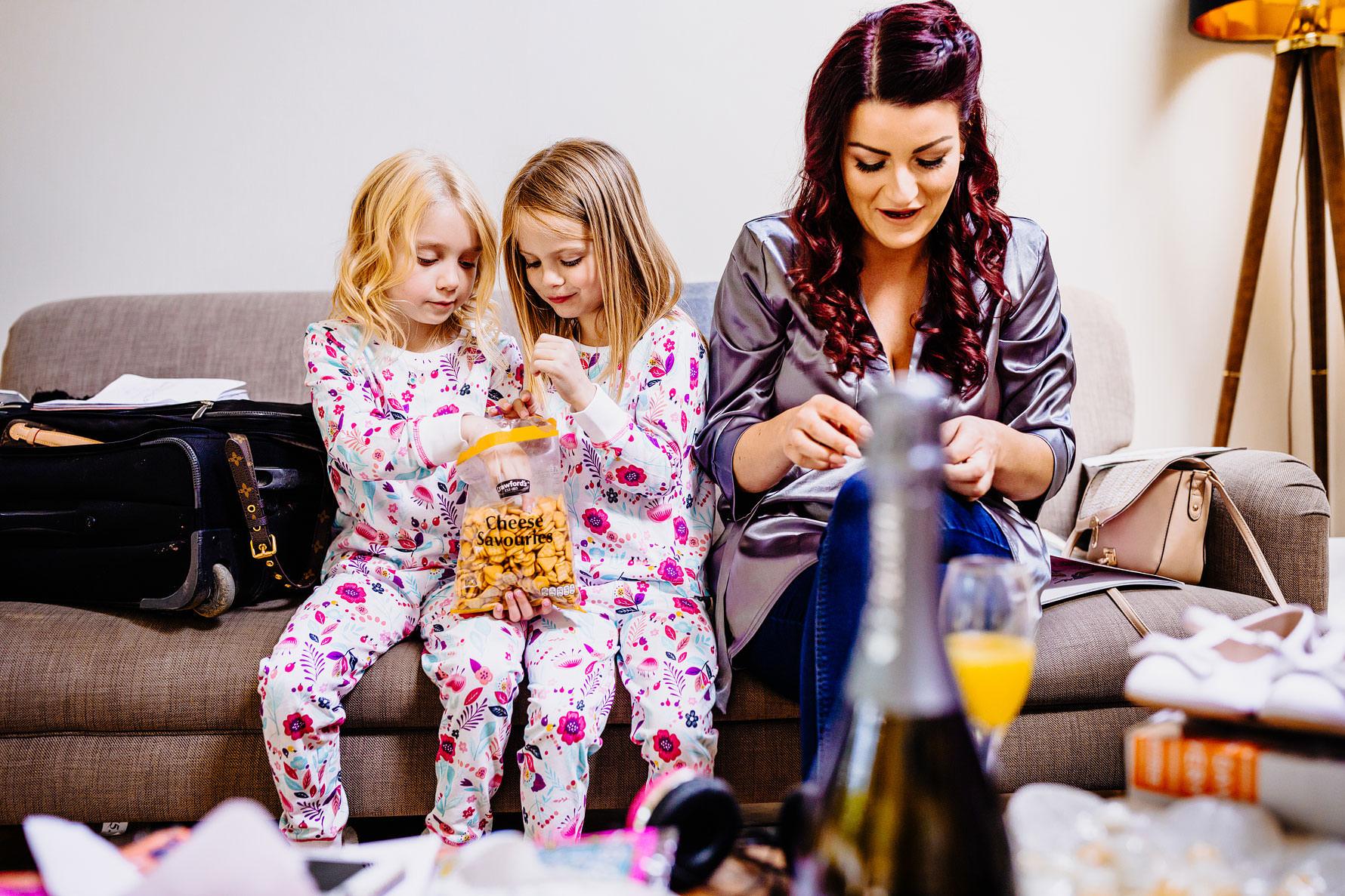 two children enjoy a snack