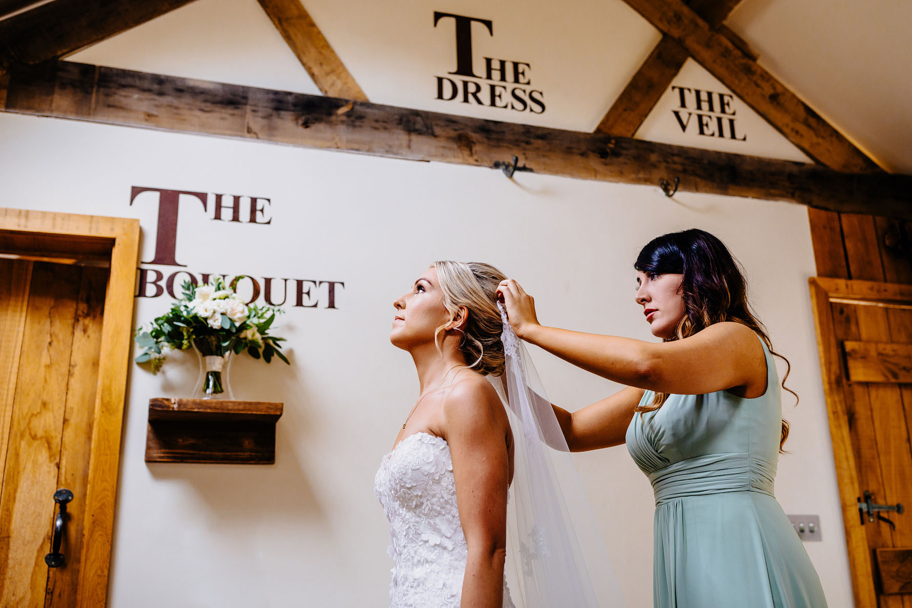 a wedding veil being fitted