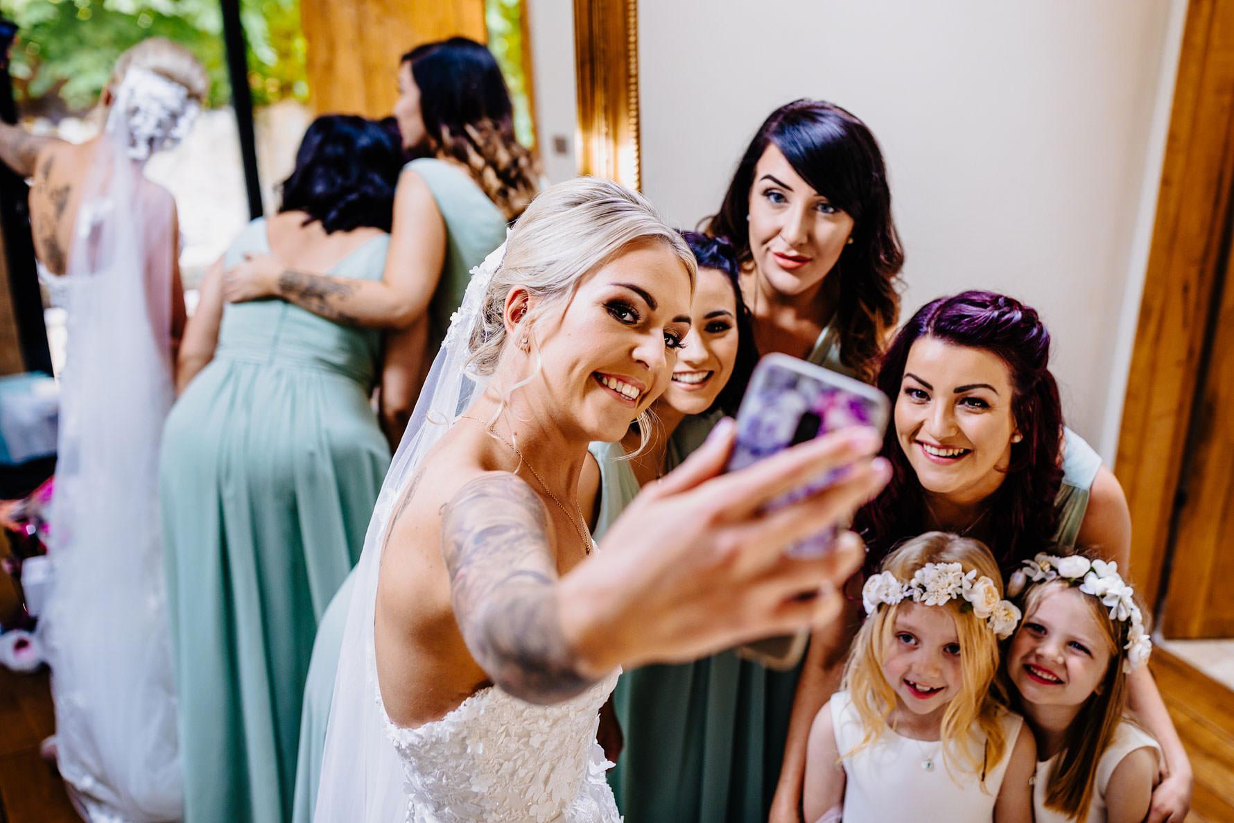 a bride taking a photograph