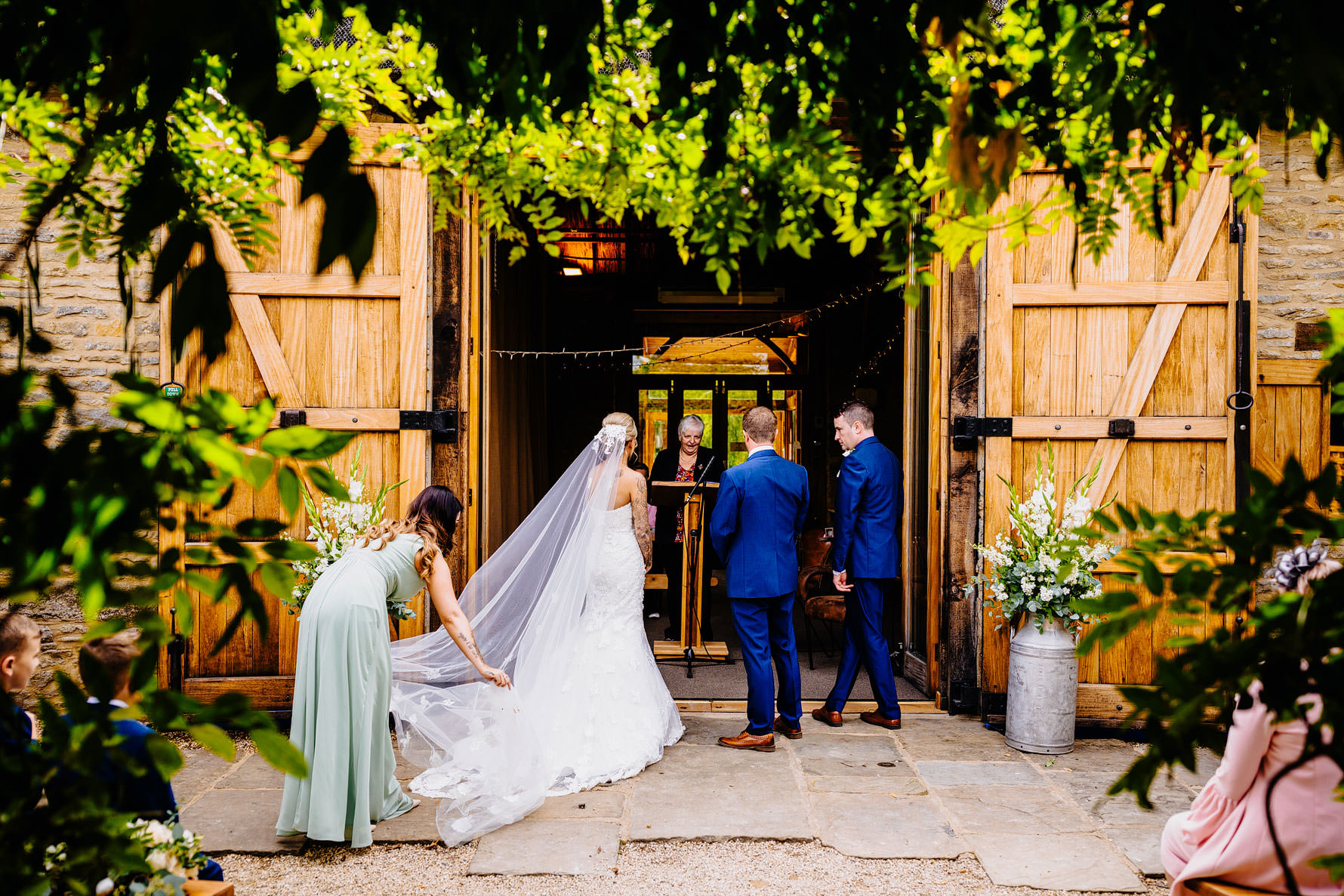a bridesmaid perfects the veil