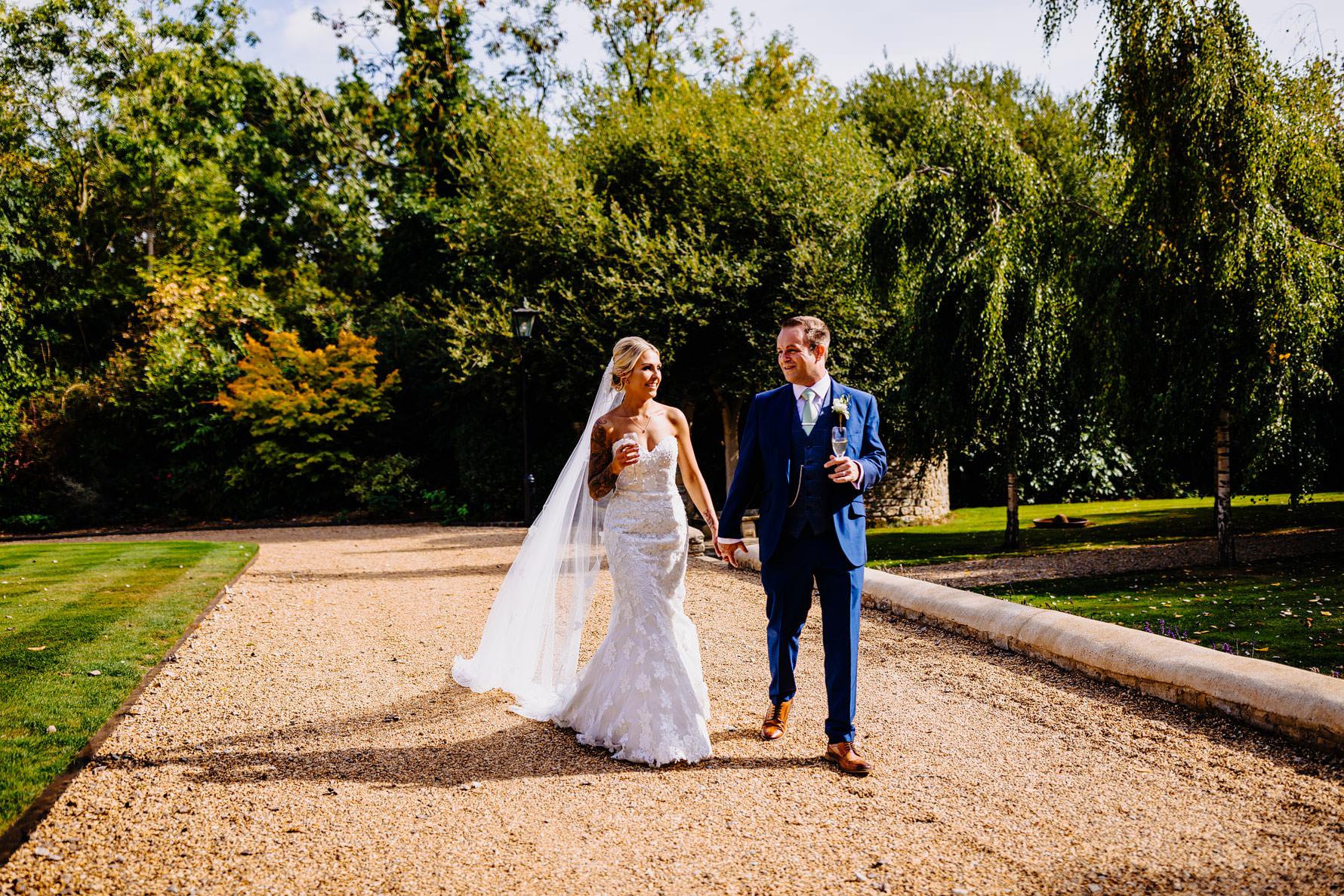 a bride and groom take a walk