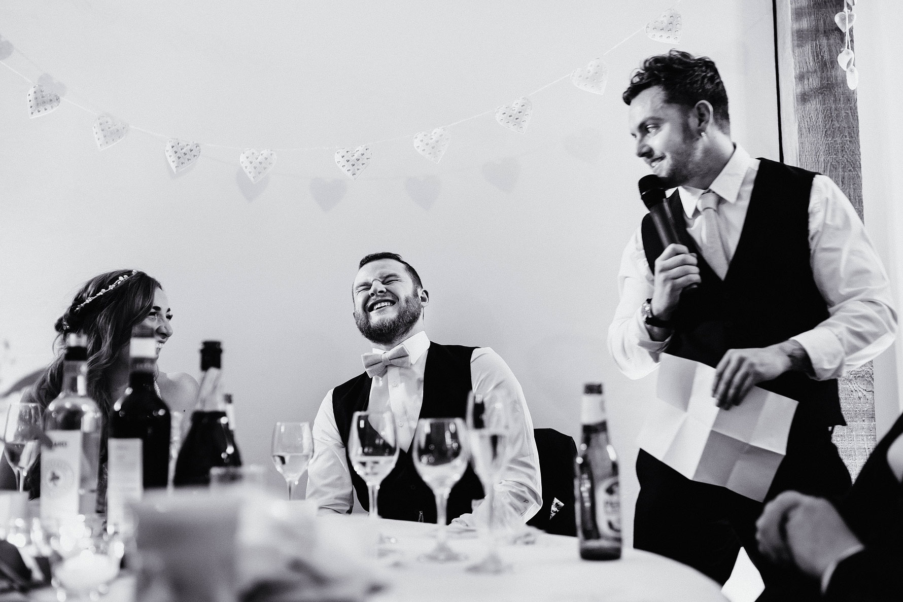 a groom laughs during the bastmans speech