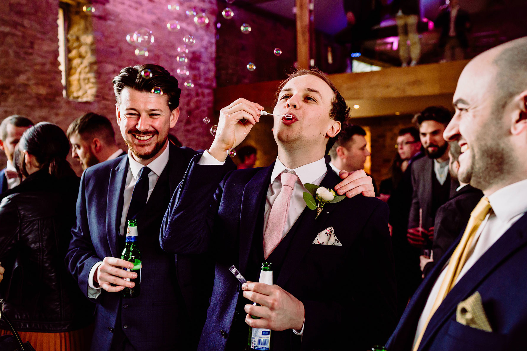 guests blow bubbles at a wedding