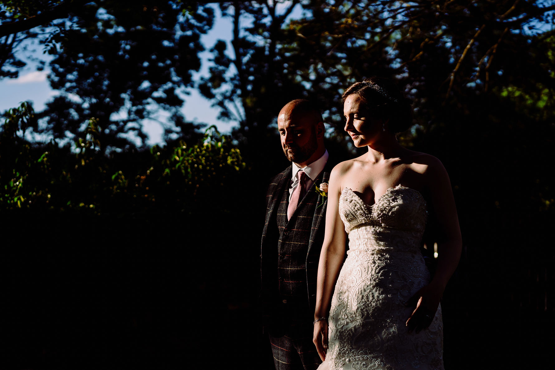 an artistic photograph of a bride and groom taken by Elliot w patching photography at Gorcott Hall.