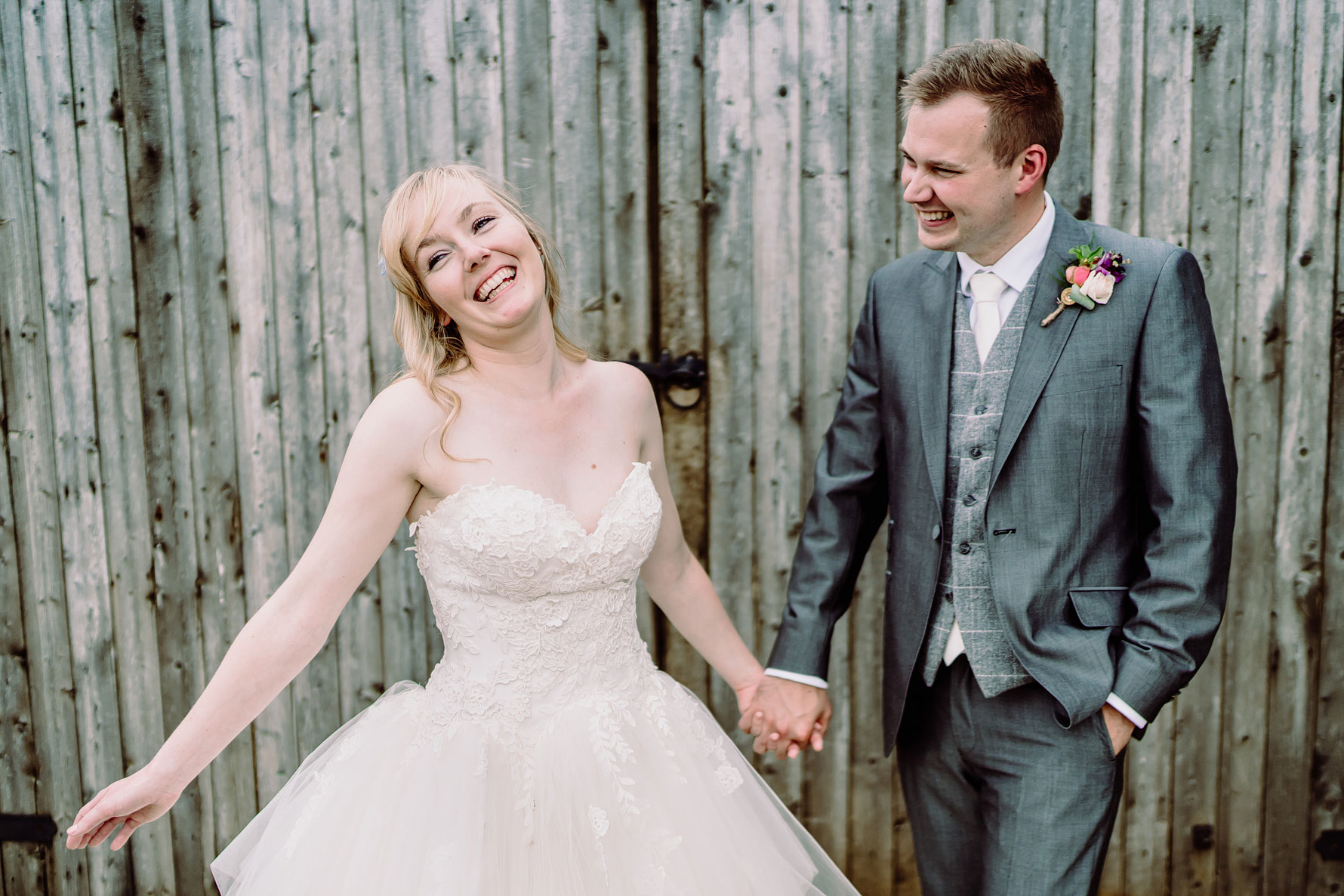 A happy couple share a moment during their wedding at dodford manor