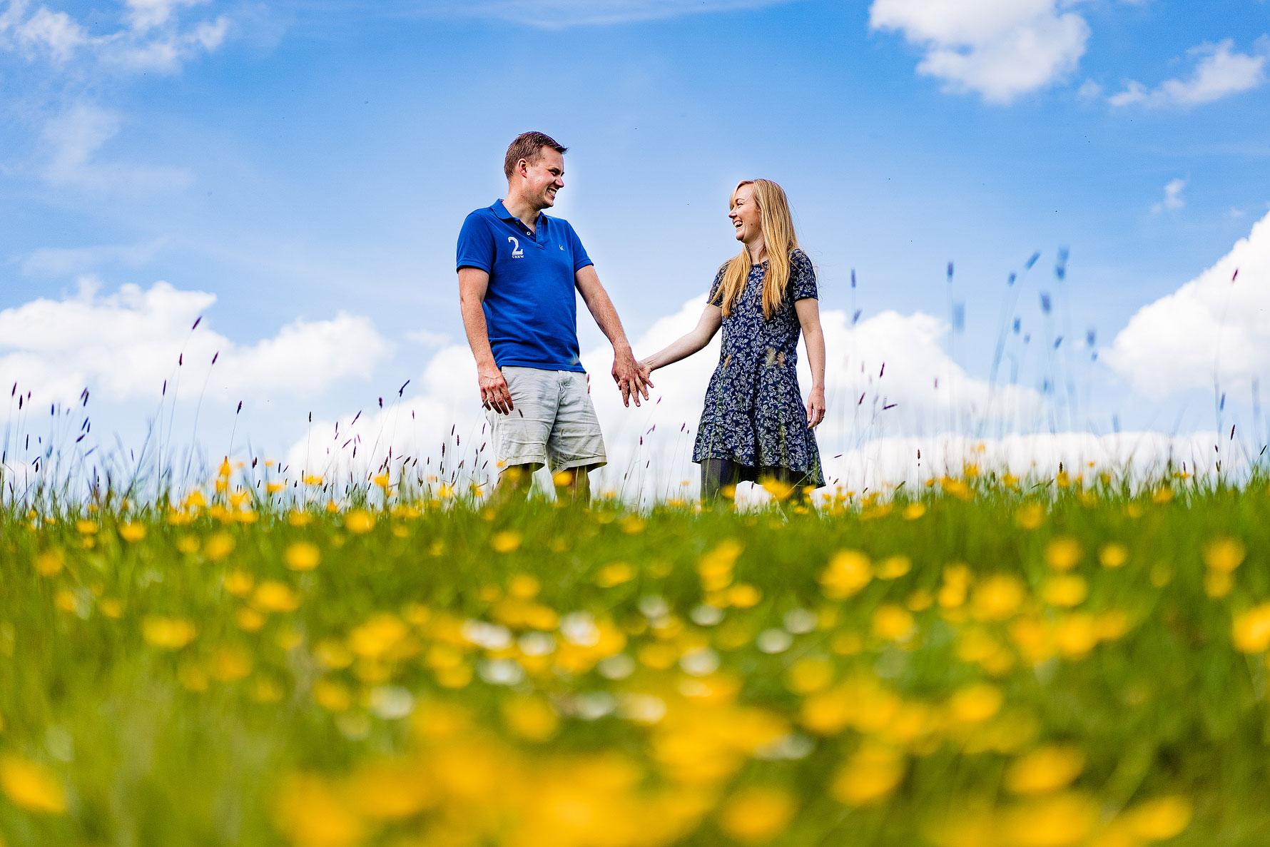 a colourful engagement shoot image of a happy couple