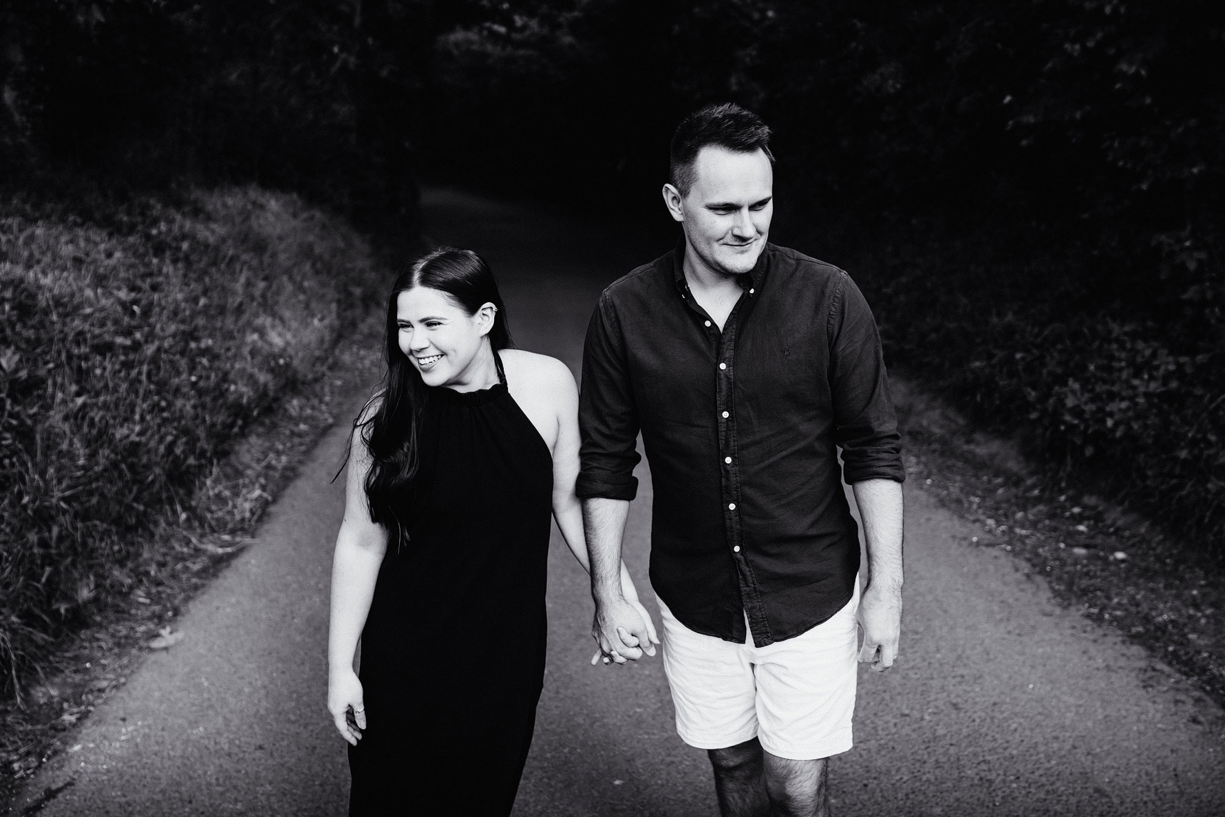 a image of a couple walking and holding hands
