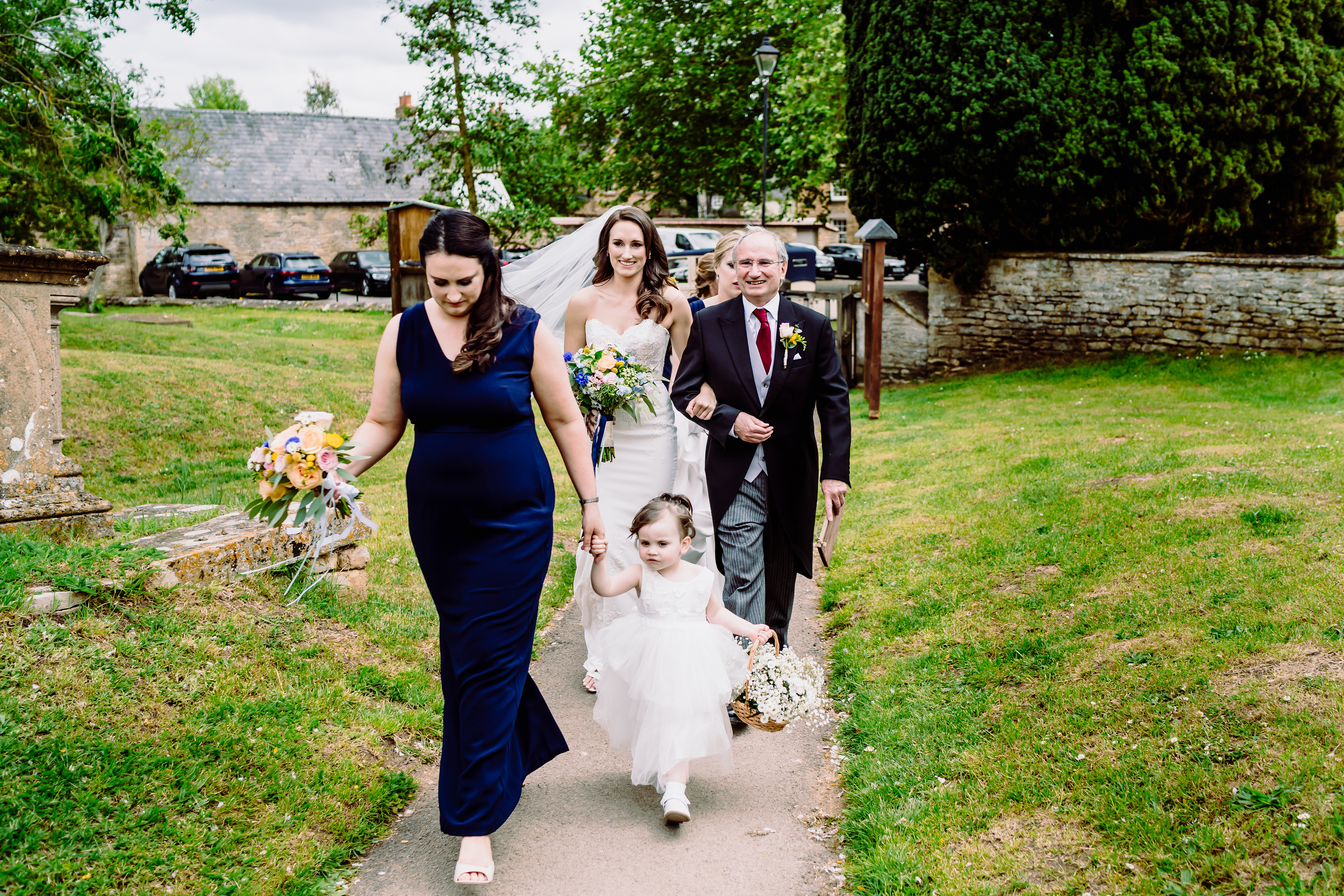 a bride and FOB walk to the church