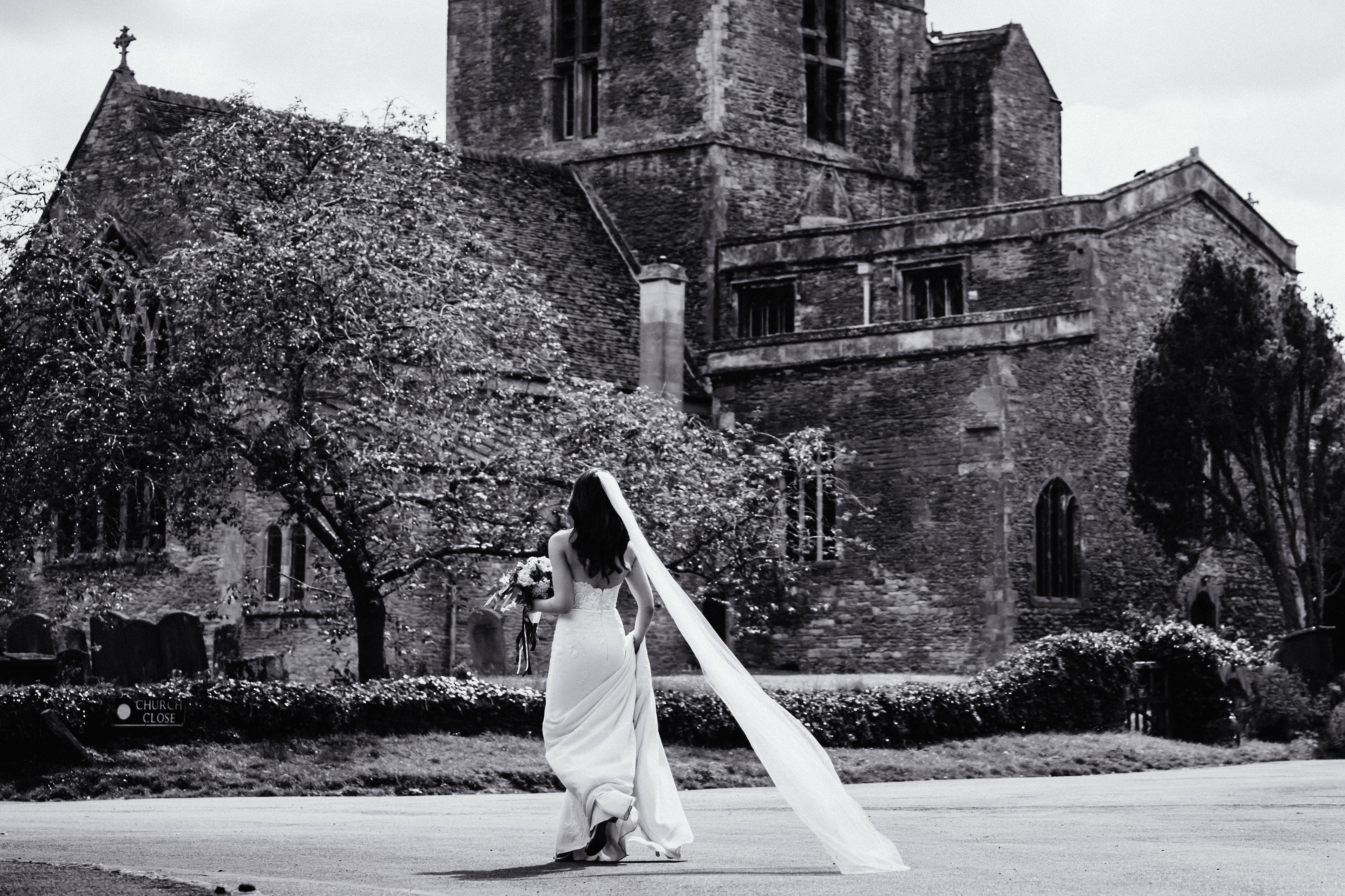 a black and white pic of a bride