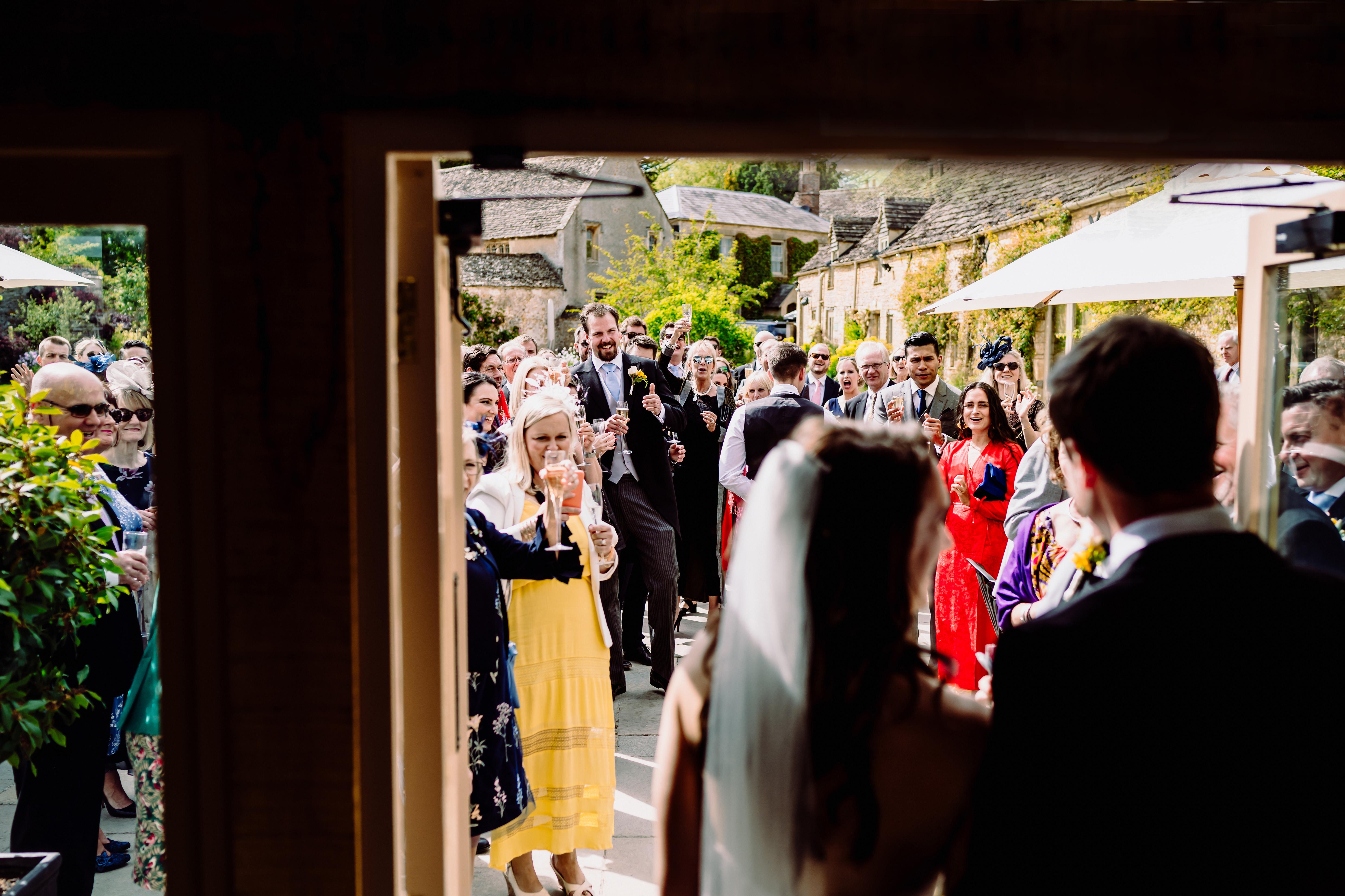 happy wedding guests greet the bride