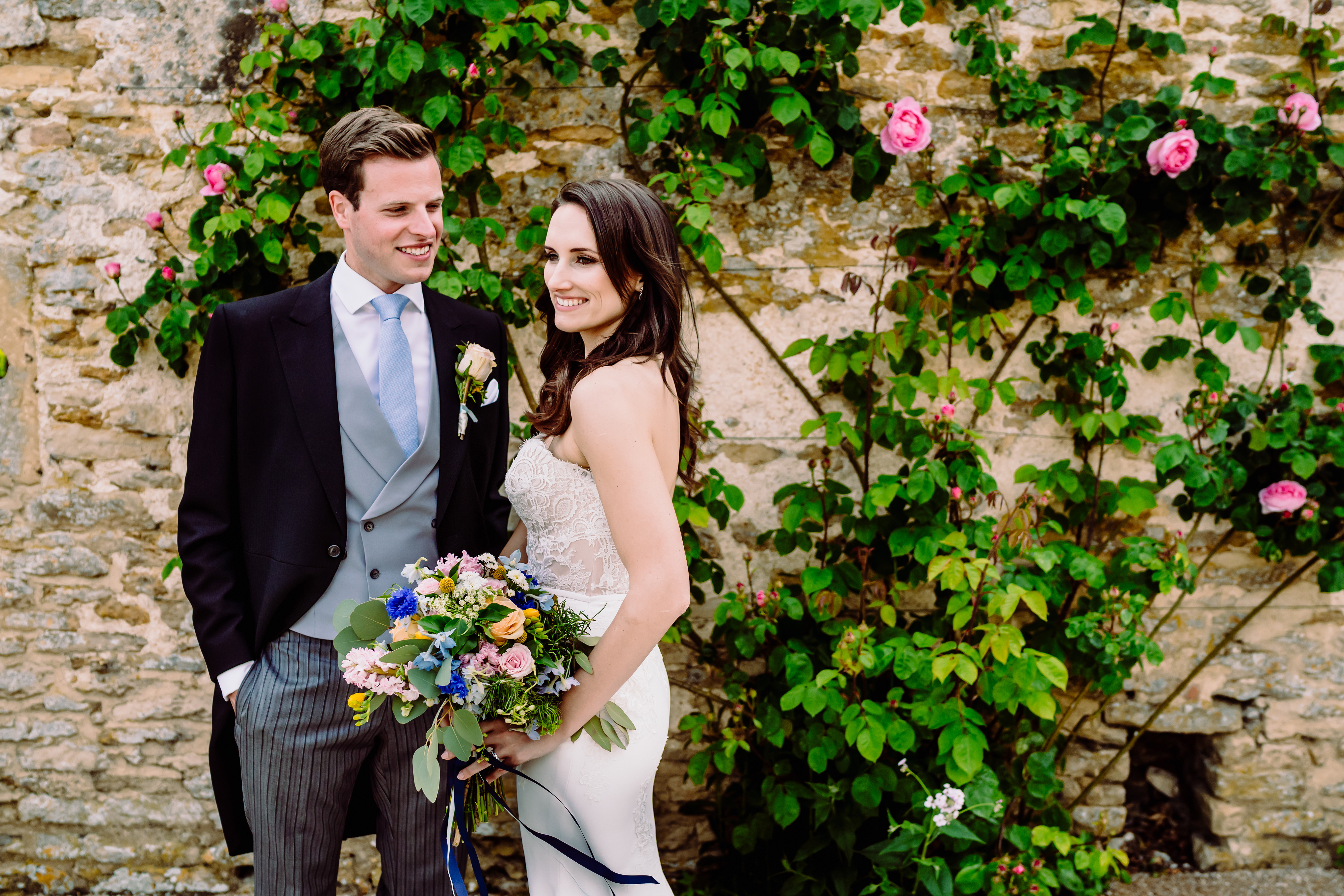 a bride and groom amongst roses