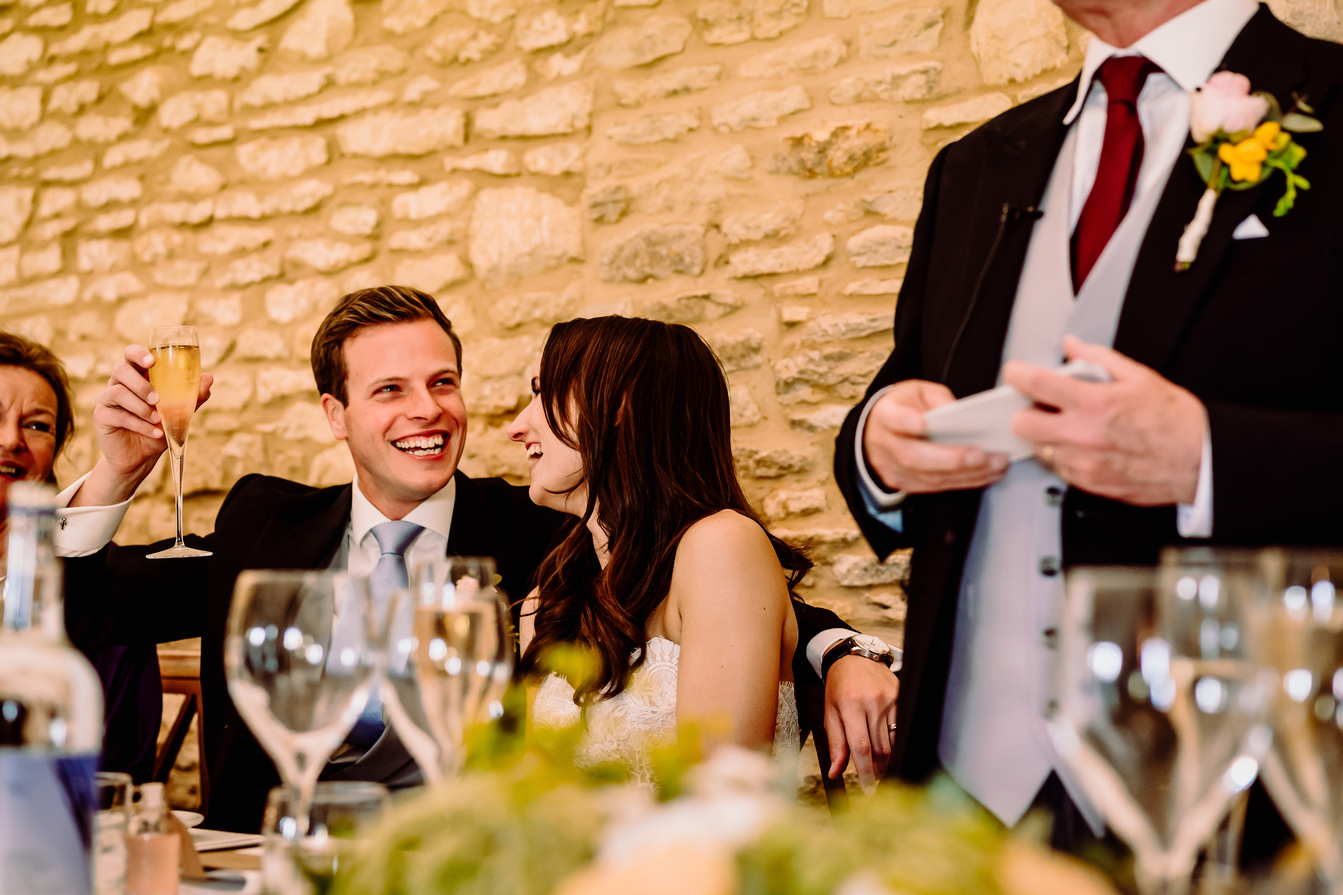 a groom smiles at his father in laws speech
